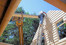 Independent Representative Constructing Log Home